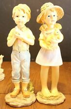 Boy and Girl figurines; 14 inches