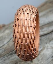 Handmade woven wicker bangle bracelet.