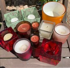 bundle of home decor candles and candle holders.