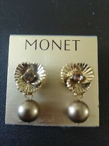 Vintage Monet earrings. Gold colour with amber coloured stone. BNWT
