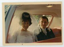 Bride & groom backseat of interior car automobile vintage color snapshot photo