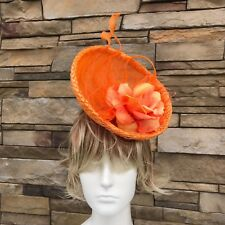 Orange Fascinator Hat.Handmade in NY. Derby,Wedding. One size Fits all.