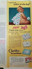 1956 curity puppy print diaper nude baby putting on the dog color AD