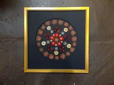 Pressed flower art with Borago Daisies with black circle mat with gold frame