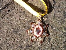 Pendant. Handmade gold/bronze bead pendant with centre bronze bead