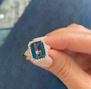 2.50Ct Emerald Cut London Blue Topaz Women's Engagement Ring 14K Rose Gold Over