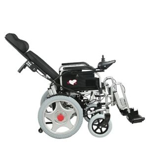 Electric powered wheelchair with adjustable headrest. Foldable and lightweight.