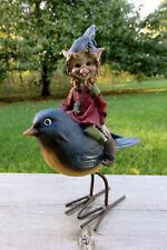 Pixie Riding Bird Blue Hat Pixie Figurine 7 in.T New Resin Metal Legs Pixies