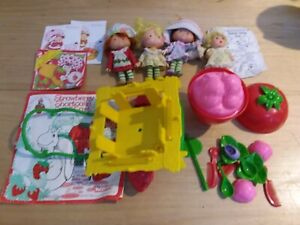 Vintage strawberry lot with snail cart and berry baby