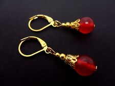 A PAIR OF DANGLY RED JADE  GOLD PLATED LEVERBACK HOOK  EARRINGS. NEW.