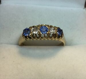 18ct Gold 0.45ct Sapphire and 0.20ct Diamond 5 Stone Ring. Size O 1/2. Stunning.