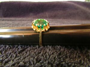 14k  Gold Ring  with Large Green Stone 4.13 grams  size  8 1/4