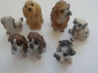 Set of seven (7) mini composite dog figurines