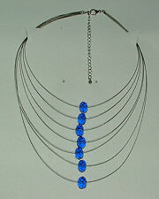 MULTI STRAND SILVER PLATED NECKLACE WITH ROW OF BLUE FACETED CRYSTAL BEADS