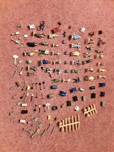 HO Scale people,  pets, tools, barrels, wheels, and AC units. 60+ pieces