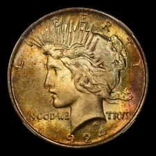 1924 $1 Peace Dollar NGC MS64. CAC. Nice toning with flashy luster.