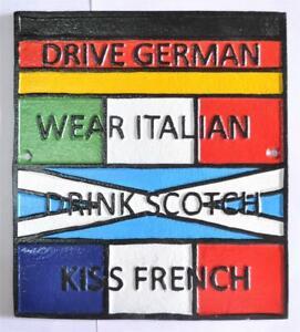 Novelty Cast Iron Wall Sign - Drive German Wear Italian Drink Scotch Kiss French