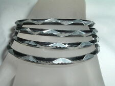 4 VINTAGE DIAMOND CUT BLACK AND SILVER ALUMINUM BANGLE BRACELETS