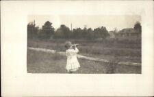 Little Girl Looking Through Binoculars or Spyglass c1910 Real Photo Postcard