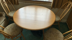 dining table and chairs and side board