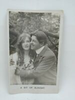 Vintage 1909 Romantic Couple Hugging Pretty Girl Postcard A Bit of Alright