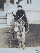 RPPC LITTLE BOY, ON A DONKEY IN FRONT OF RESIDENCE! REAL AZO PHOTO 1910 POSTCARD