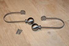 ONE PAIR OF STAINLESS STEEL TIE-BACKS. BALL ENDS. MATCHING SCREWS PROVIDED