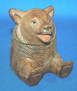 A charming bear head inkwell, 19th century, carved wooden, painted features