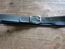 A pretty green plastic belt with a circle design impressed on it.