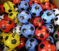 """100 PLASTIC FOOTBALLS 8.5"""" FLAT PACKED UN-INFLATED"""
