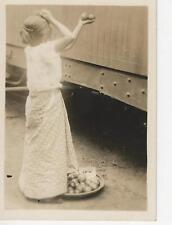 Found photo young girl selling apples to people on train 1930's snapshot
