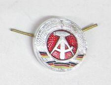 Cocarde en métal pour coiffure troupe  ex-Allemagne de l'Est  - DDR -