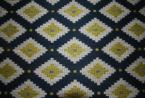 """""""Little Jefe"""" upholstery fabric by James Malone, hopi, remnant of 3.45 m"""