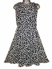 Plus size sleeveless black/white spotted knee length georgette dress