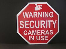 Sign: WARNING SECURITY CAMERAS IN USE