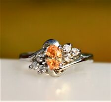 Sun color CZ stone surrounded with clear CZ silver tone  RING size 6