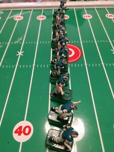 Vintage Tudor Electric Football Dolphins with black shoes and bases