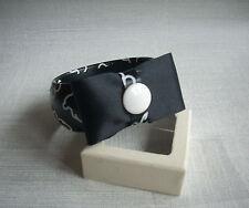 bracelet jonc rigide noir avec oursons et noeud noir