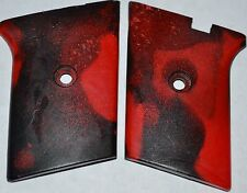 Phoenix Arms Raven 25 ACP pistol grips red and black swirl smooth plastic
