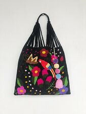 Black handmade in Mexico embroidered colorful hobo bag with pom poms