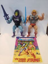 Battle Armor He-man & Skeletor with swords and Comic MOTU