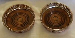 A Pair Of Vintage Silver Plated Wine Coasters.