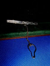 A brand silver tie clip with chain,marked Contrasted 83,5%