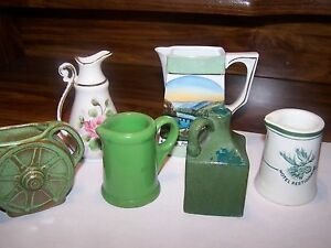 GROUP OF SIX COLLECTIBLE CREAM PITCHERS