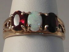 690F LADIES 9CT GOLD OPAL AND RUBY TRILOGY RING SIZE N 1/2