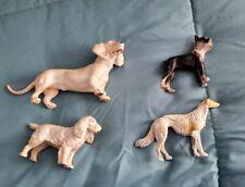 (4) VINTAGE CAST IRON DOG
