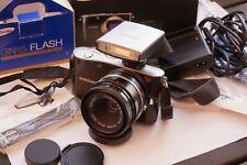 Samsung nx100+2 adattatori eos-nx e m42-eos lente Carl zeiss 50mm + flash GN15