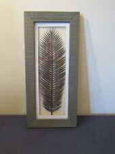 "FRAMED PLASTIC LEAF WALL HANGING 18"" x 8""."