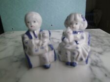 TWO VINTAGE PORCELAIN FIGURINES BOY AND GIRL WITH DOG AND CAT  BLUE WHITE GOLD