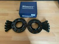 ALLOY WHEEL SPACERS 12mm X 2 BLACK BIMECC + 10 X BOLTS FOR VW GOLF 5X112 57.1